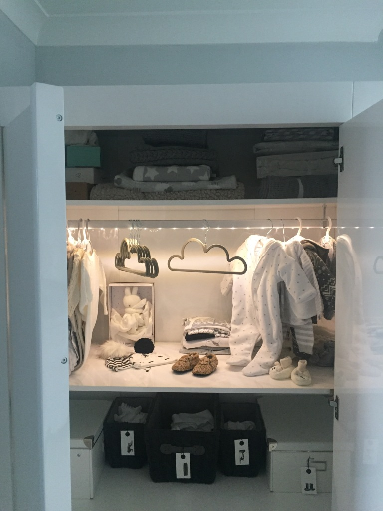 Organised wardrobe, organised nursery, playing shops, baby clothes